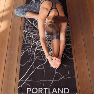 Stretching on personlized print yoga mat with Portland Map