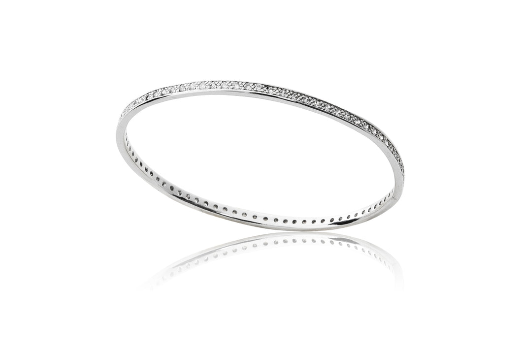 A timeless favourite. platinum finished bangle adorned with delicate cubic zirconia stones.