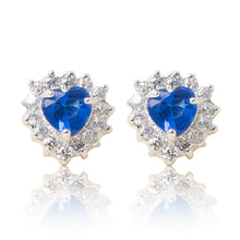 Load image into Gallery viewer, A beautiful tribute to the heart. Delicate rhodium plated studs with clear cubic zirconia stones framing a subtle blue heart stone at the centre. For pierced ears. Side view (Butterfly and pole closure)