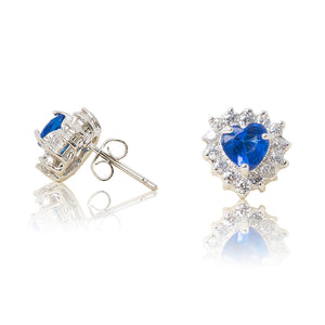 A beautiful tribute to the heart. Delicate rhodium plated studs with clear cubic zirconia stones framing a subtle blue heart stone at the centre. For pierced ears. Side view (Butterfly and pole closure)