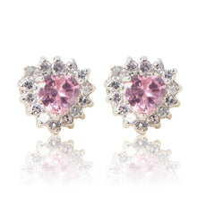 Load image into Gallery viewer, A beautiful tribute to the heart. Delicate rhodium plated studs with cubic zirconia stones framing a subtle pink heart stone at the centre. For pierced ears.