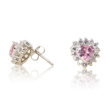 Load image into Gallery viewer, A beautiful tribute to the heart. Delicate rhodium plated studs with cubic zirconia stones framing a subtle pink heart stone at the centre. For pierced ears. Side view (Butterfly and pole closure)