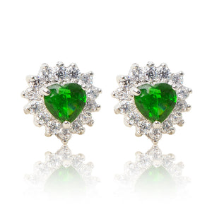 A beautiful tribute to the heart. Delicate rhodium plated studs with clear cubic zirconia stones framing a subtle green heart stone at the centre. For pierced ears.
