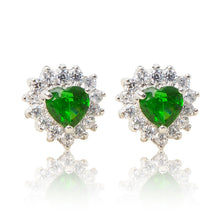 Load image into Gallery viewer, A beautiful tribute to the heart. Delicate rhodium plated studs with clear cubic zirconia stones framing a subtle green heart stone at the centre. For pierced ears.