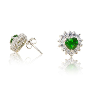A beautiful tribute to the heart. Delicate rhodium plated studs with clear cubic zirconia stones framing a subtle green heart stone at the centre. For pierced ears. Side view (Butterfly and pole closure)