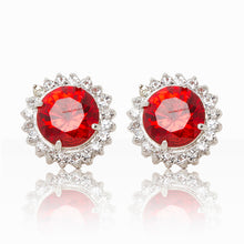 Load image into Gallery viewer, Delicate rhodium plated studs with a red centre surrounded by a halo of cubic zirconia stones. For pierced ears.