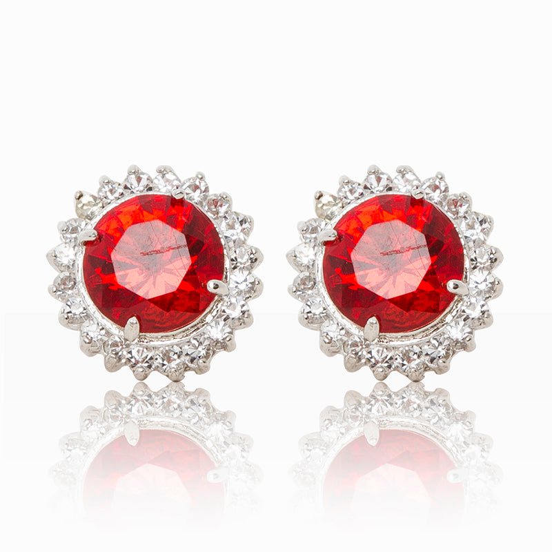 Delicate rhodium plated studs with a red centre surrounded by a halo of cubic zirconia stones. For pierced ears.