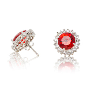 Delicate rhodium plated studs with a red centre surrounded by a halo of cubic zirconia stones. For pierced ears. Side view (Butterfly and pole closure)