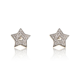 A pair of rhodium plated celestial star stud earrings set with cubic zirconia and a star centre cut out. For pierced ears.