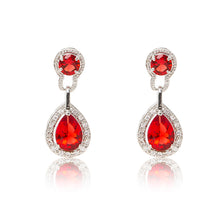 Load image into Gallery viewer, Dazzling rhodium plated earrings with centre stones of red cubic zirconia framed by clear cubic zirconia stones.
