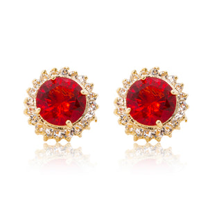 Delicate 18ct yellow gold plated plated studs with a red centre surrounded by a halo of cubic zirconia stones. For pierced ears.