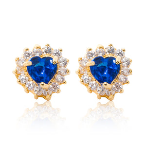 A beautiful tribute to the heart. Delicate 18ct yellow gold plated studs with clear cubic zirconia stones framing a subtle blue heart at the centre.