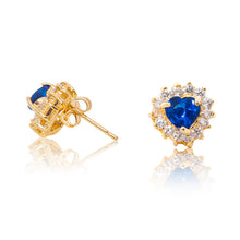 Load image into Gallery viewer, A beautiful tribute to the heart. Delicate 18ct yellow gold plated studs with clear cubic zirconia stones framing a subtle blue heart at the centre. Side view (Butterfly and pole closure)