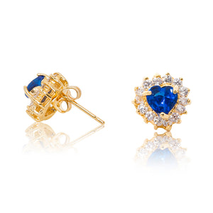 A beautiful tribute to the heart. Delicate 18ct yellow gold plated studs with clear cubic zirconia stones framing a subtle blue heart at the centre. Side view (Butterfly and pole closure)