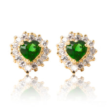 Load image into Gallery viewer, A beautiful tribute to the heart. Delicate 18ct yellow gold plated studs with clear cubic zirconia stones framing a subtle green heart at the centre.