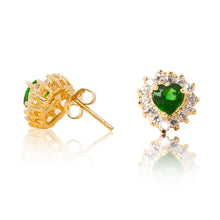 Load image into Gallery viewer, A beautiful tribute to the heart. Delicate 18ct yellow gold plated studs with clear cubic zirconia stones framing a subtle green heart at the centre. Side view (Butterfly and pole closure)