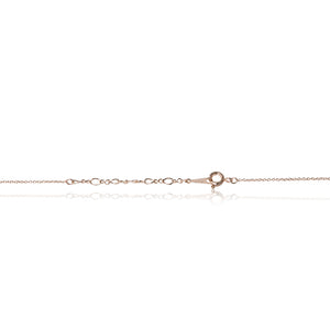 A dainty 18ct yellow gold plated cubic zirconia encrusted elephant pendant and chain trigger clasp chain fastening