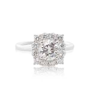 A graceful 925 sterling silver crown halo ring with a round brilliant cubic zirconia centre stone. Front view