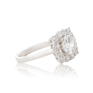 A graceful 925 sterling silver crown halo ring with a round brilliant cubic zirconia centre stone. Side shank view