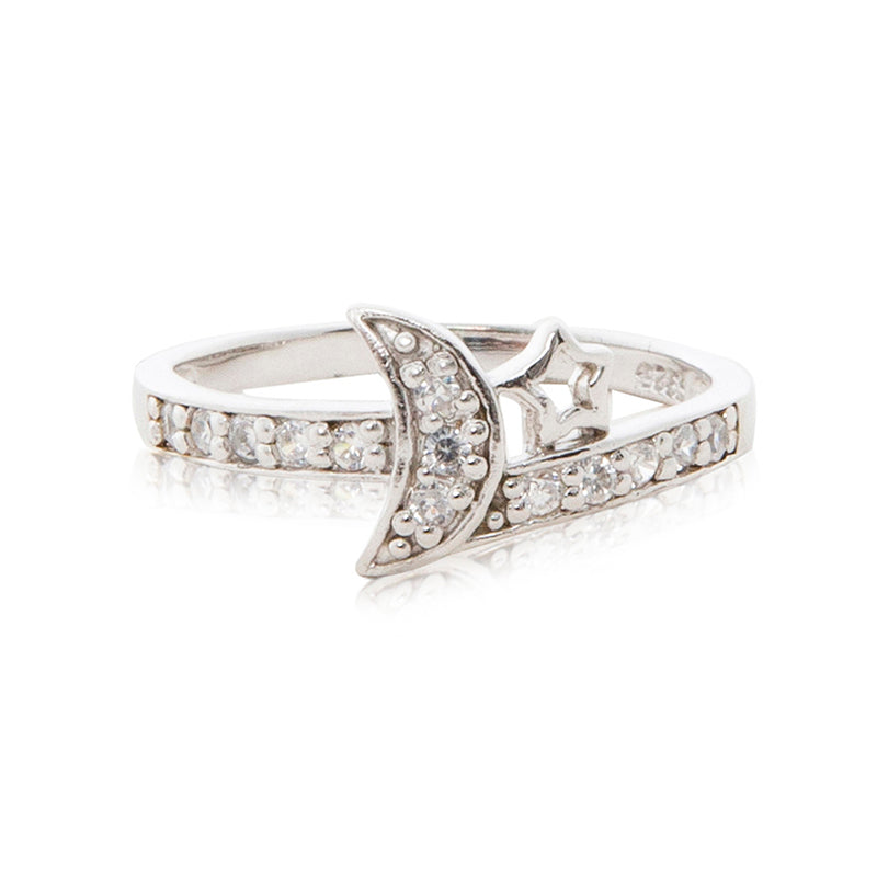 A charming 925 sterling silver moon and star ring encrusted in brilliant cut cubic zirconia stones and diamond-look shoulders.