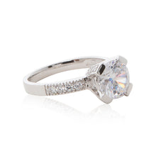 Load image into Gallery viewer, A dazzling 925 sterling silver round brilliant claw set CZ solitaire engagement ring style CZ half band ring. Side view half eternity band