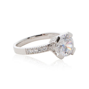 A dazzling 925 sterling silver round brilliant claw set CZ solitaire engagement ring style CZ half band ring. Side view half eternity band