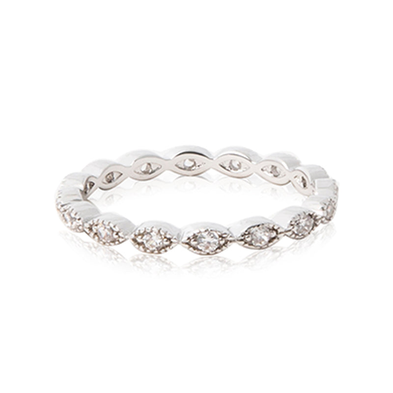 Rhodium plated band decorated with beaded oval shapes framing round brilliant CZ stones.