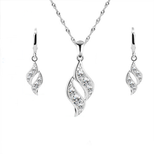 Load image into Gallery viewer, A 925 sterling silver twist like pendant and earrings set. For pierced ears.