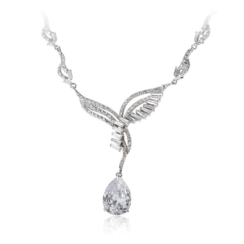 A beautiful statement platinum finished pear drop earrings and necklace set. Evening necklace