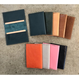 Leather Slimfold Wallets, current color offerings: Shiny Teal, Teal, Forest Green, Light Tan, Brown, Suede Brown, Bright Orange, Spotted Off White, Bubblegum Pink, and Black