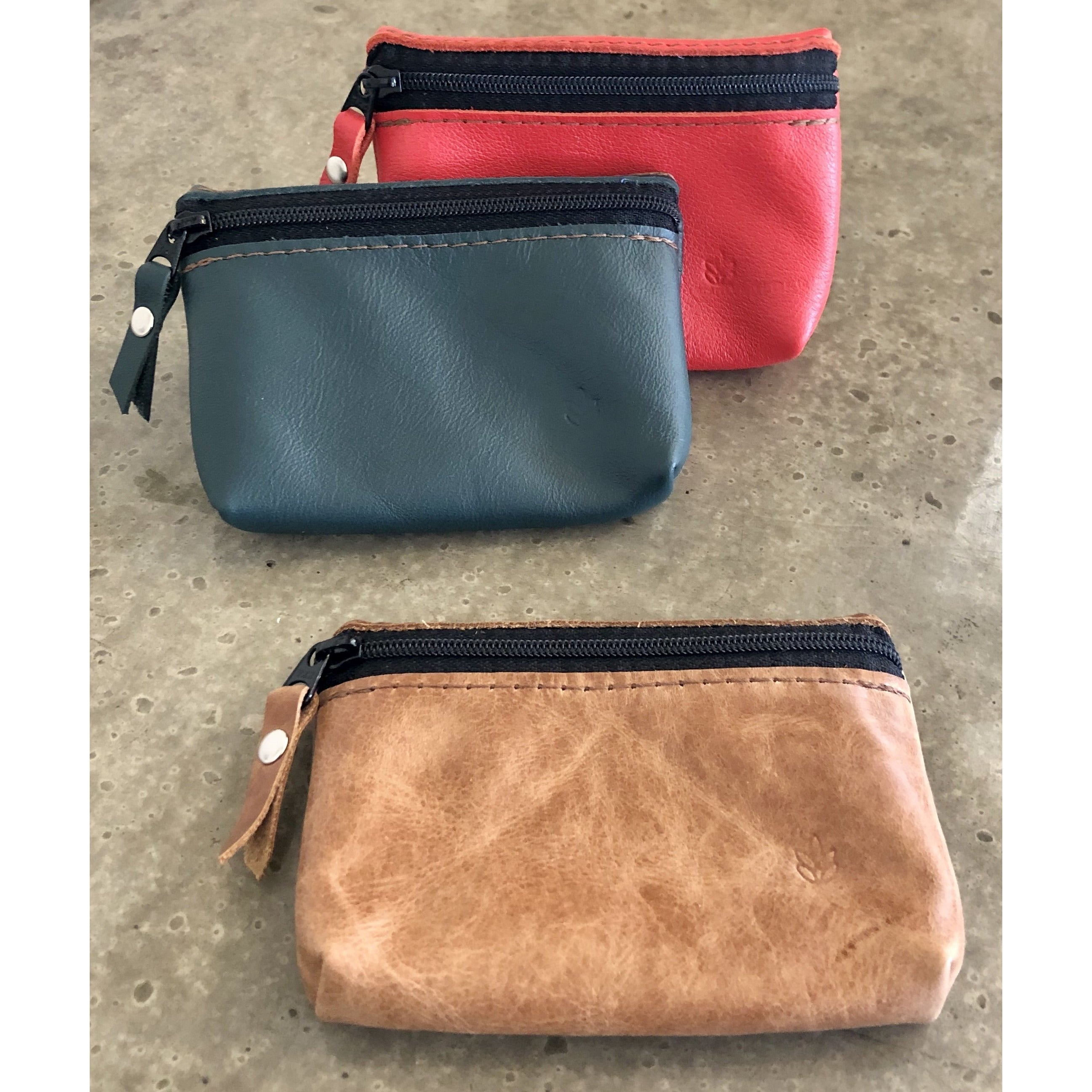 Leather zipper Pouch in beige, teal, and bright orange, with front zipper