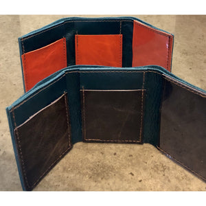 Leather Tri-Fold Wallets in shiny teal, with dark brown or bright orange pockets