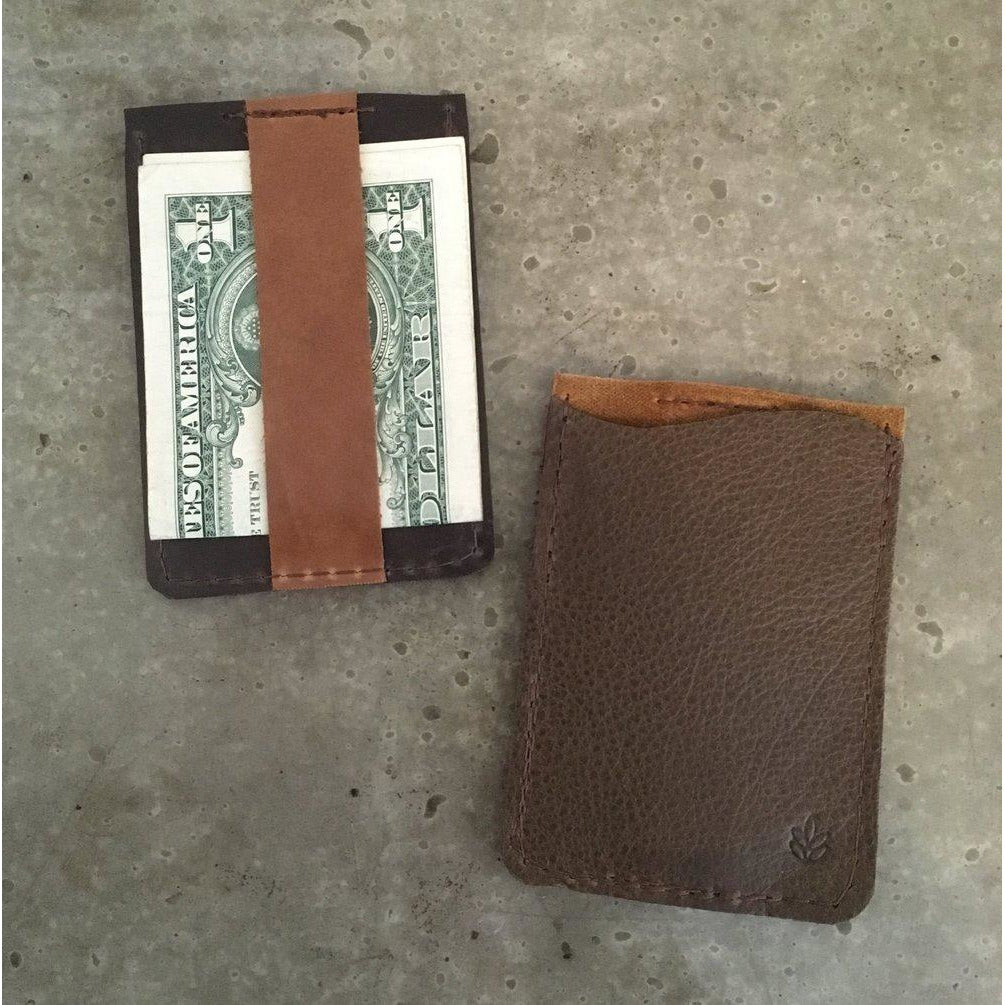Leather Business Card Holder in Brown, holding a bill
