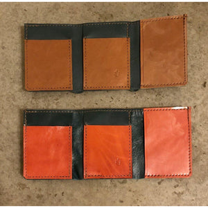 Leather Tri-fold Wallets, teal with brown pockets and shiny teal with bright orange pockets