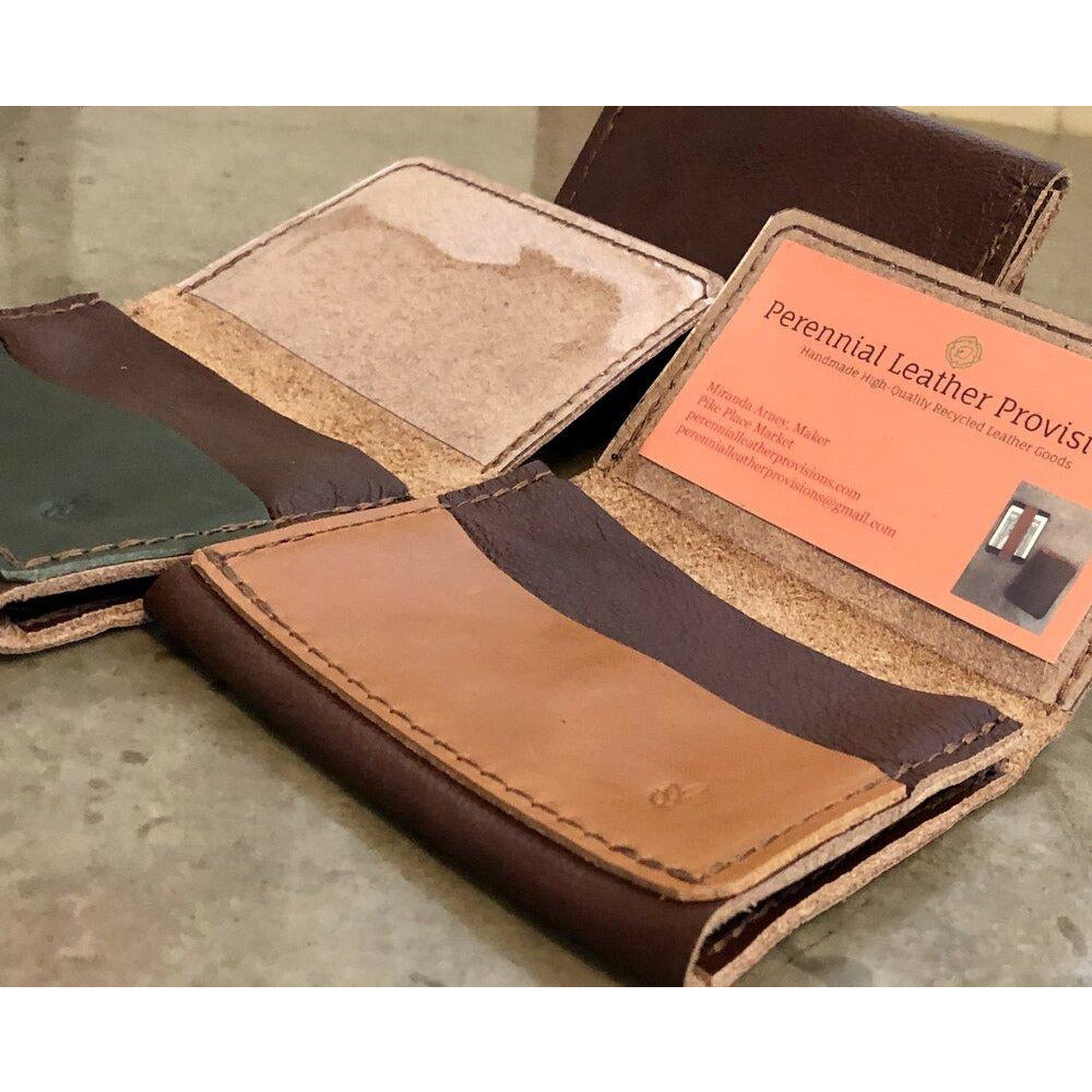 Leather Flip Pouch in Dark Brown, pictured with brown and green pockets