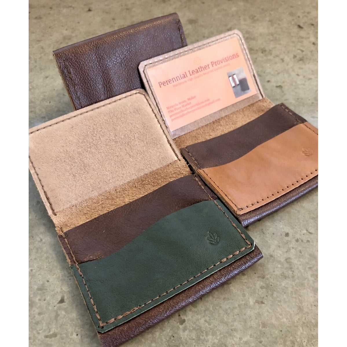 Leather Flip Pouch in Dark Brown, pictured with brown and green pockets, overhead view