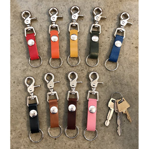The Perfect Leather Belt Loop Key Chain, in medium length. Current color offerings include: red, orange, yellow, forest green, turquoise, black, light brown, dark brown, and bubblegum pink