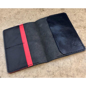 Leather Passport Wallet in black with red pocket accent