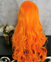 Bright orange long curly costume wig by Shiny Way Wigs Melbourne VIC