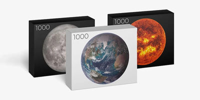 Our Newest Puzzles Are Round 1,000-piece Puzzles of the Earth, Moon, and Sun