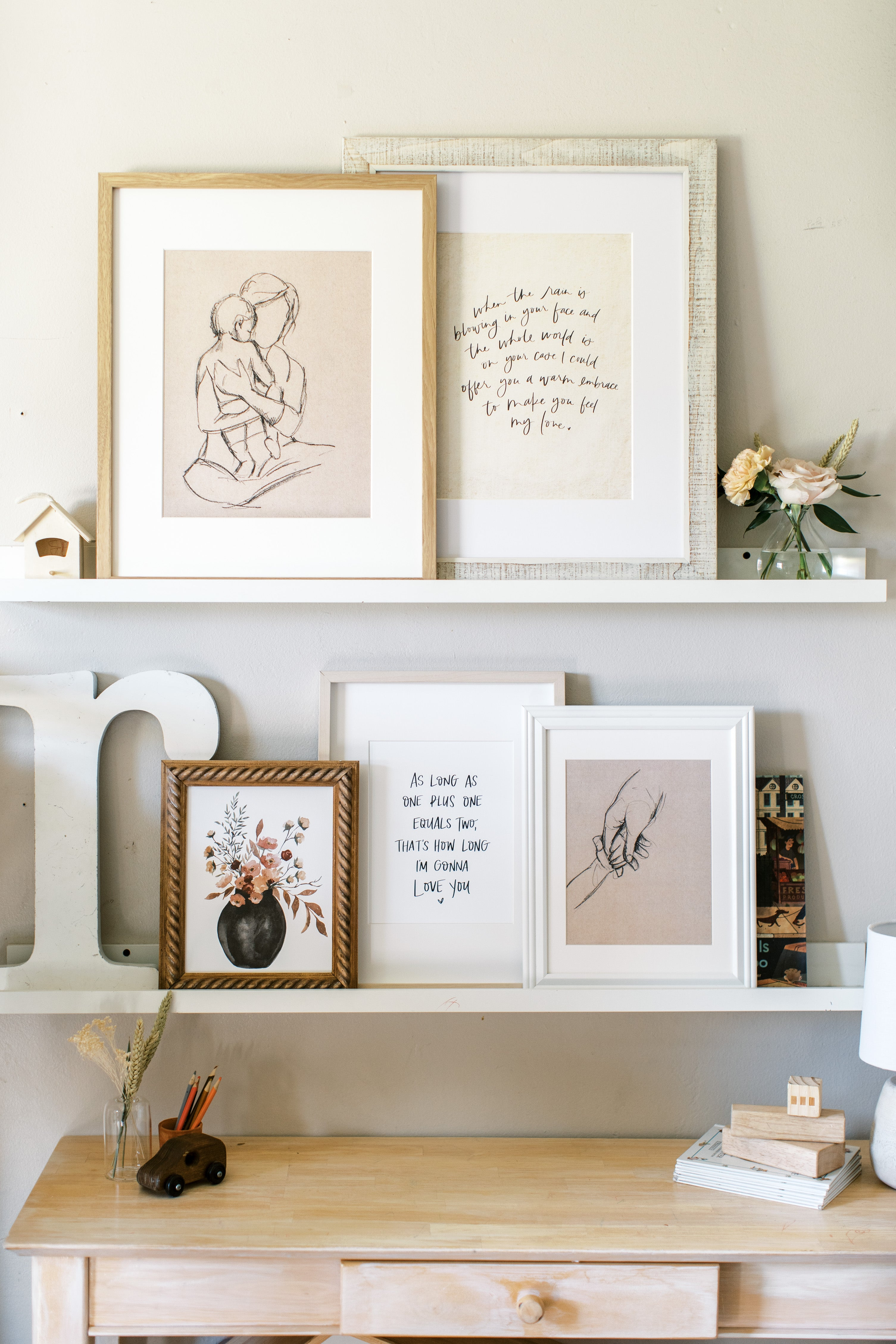 paintings on a shelf in girls room