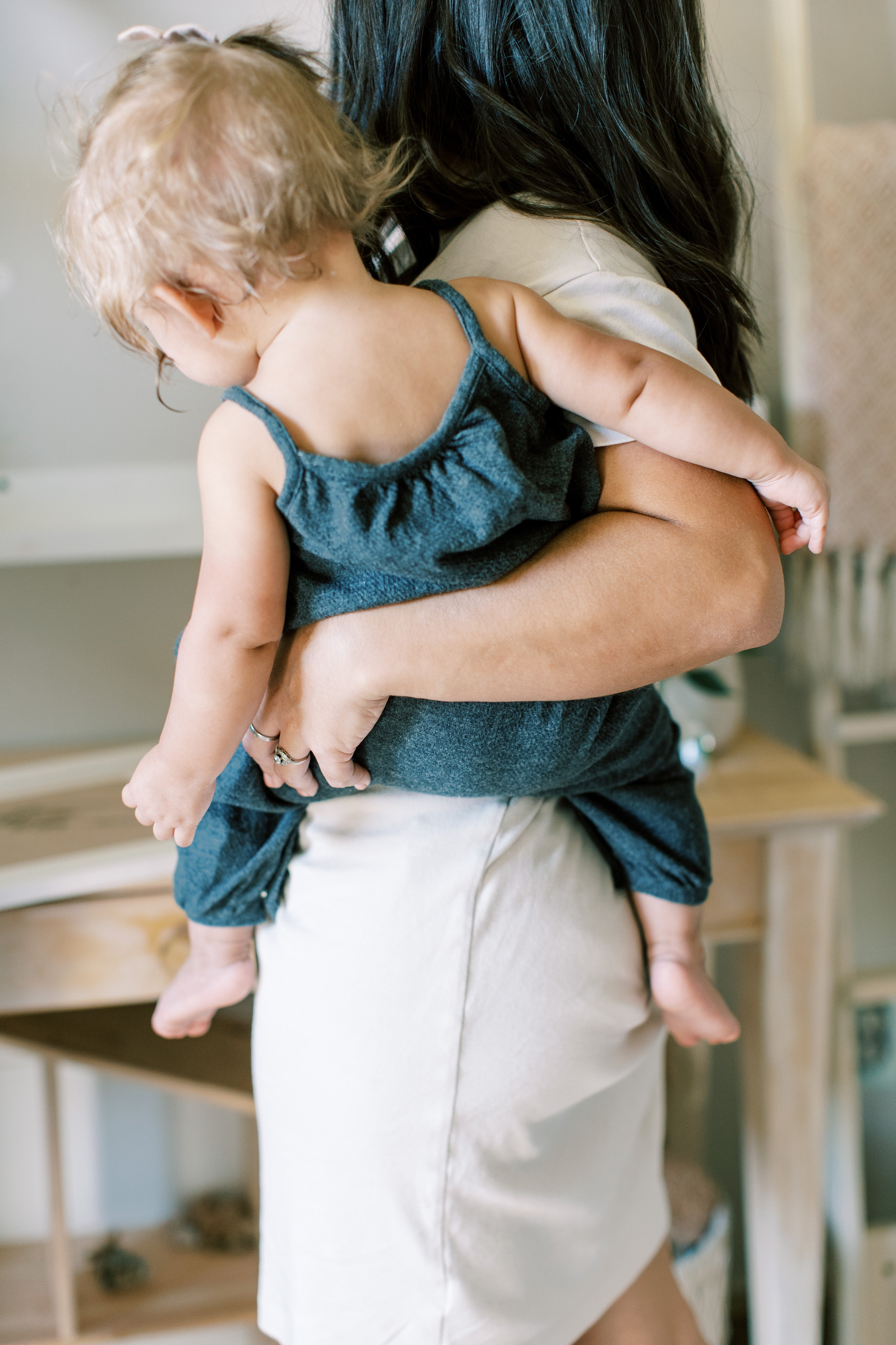 mom holding baby on hip