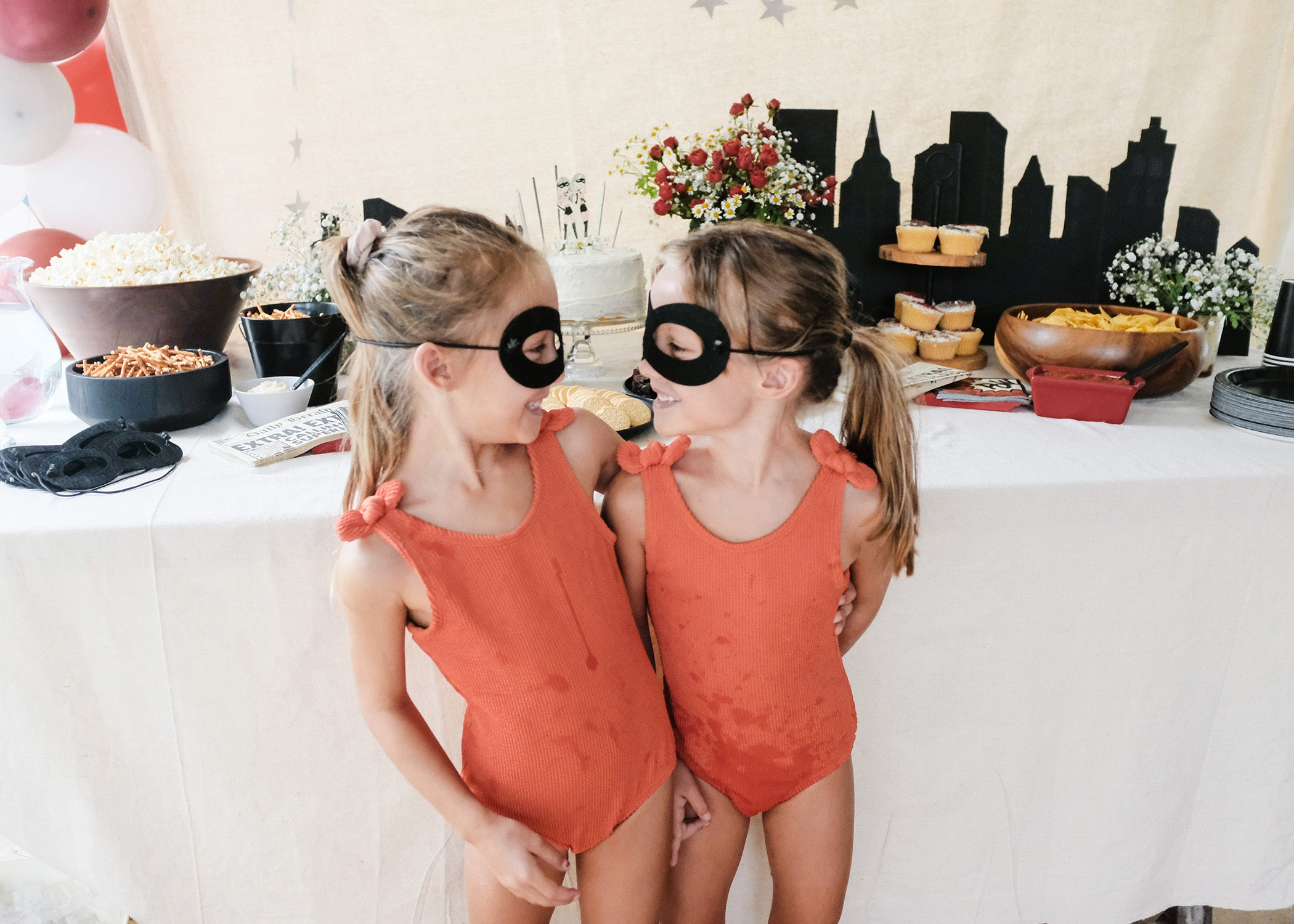 twins dress up in super hero outfits