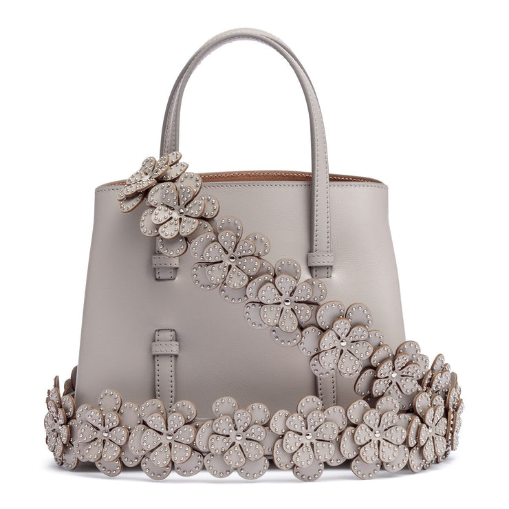 Grey leather mini tote with studded floral strap
