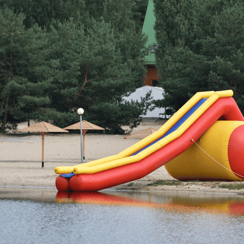 Beach anchoring an inflatable water slide with GroundGrabba ground anchors