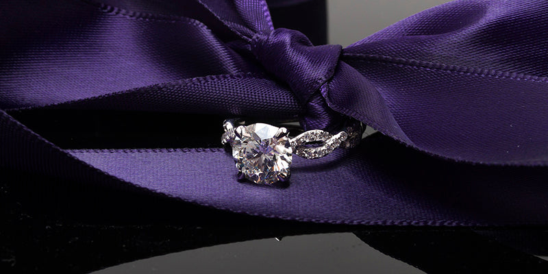engagement ring with twisting shank inside bow