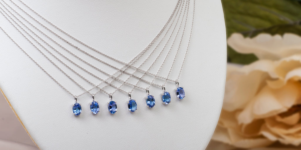 matching bridesmaids pendants with oval tanzanites