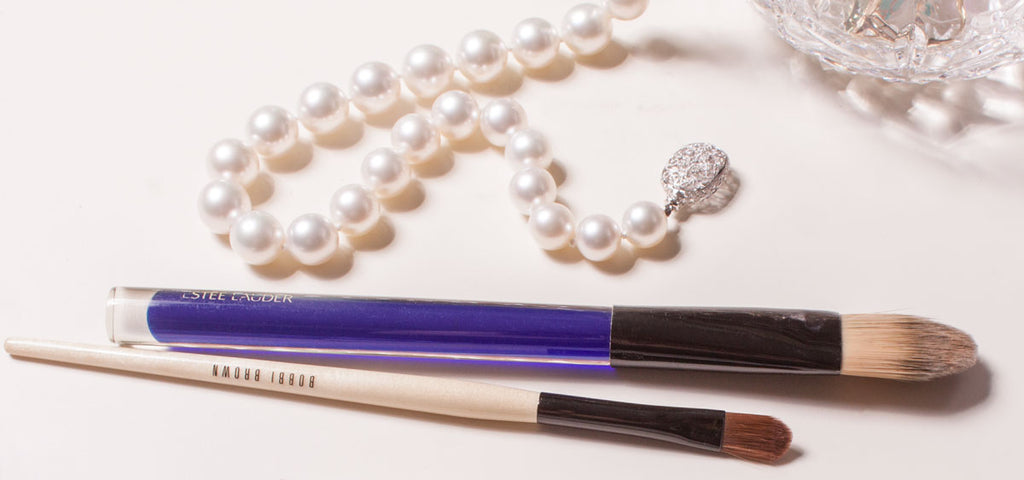 pearls and soft makeup brush for cleaning