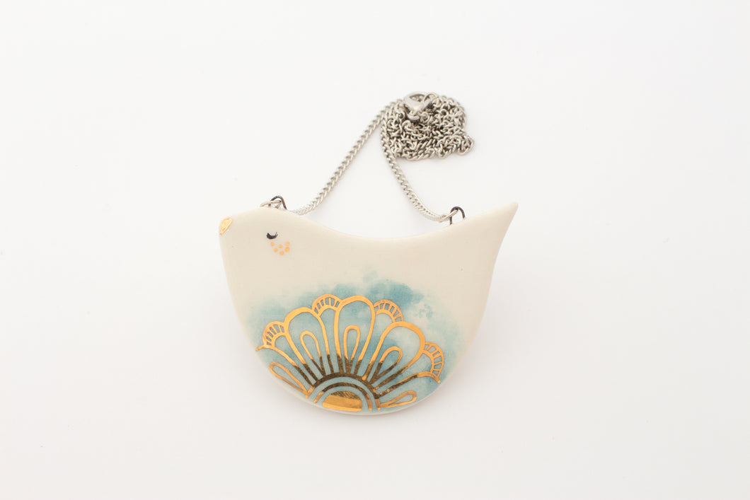 Birdie Necklace in Blue with Golden Flower - O I A  ceramics