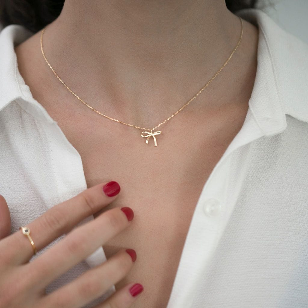 Solid 14k gold necklace with bow pendant
